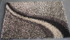 This is polyester shaggy rug, available in various shades & styles. Dimension available sizes- 40X60cm, 50X80cm, 60X90cm, 90X150cm, 120X180cm.