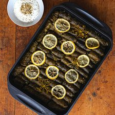 Dolma (Grape Leaves Stuffed with Rice)--This recipe for stuffed grape leaves, from chef Lior Lev Sercarz, an expert in spice blending, uses both lemon juice and zest to enhance the flavor of the stuffing. Turkish Recipes, Greek Recipes, Ethnic Recipes, Meze Recipes, Saveur Recipes, Veggie Recipes, Stuffed Grape Leaves, Dried Plums, Mediterranean Dishes