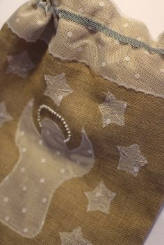 Burlap is the best, sturdy fabric to hold all those lovely gifts Santa is going to bring. I made this with a lace inner lining which comes over the top as a decorative trim. Angel and stars are appliqued on and decorated with hand embroidery. The angel's halo is beaded. The fastening is with a green satin ribbon. Dimenions - 60 x 45 cms Price - £20