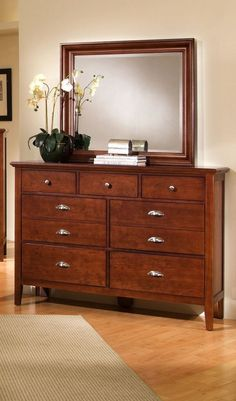Twilight Cherry Large Dresser & Mirror  $799.99 Sku:145193 Dimensions:56Wx18Dx80H The Twilight collection has a simplistic look that makes it easily placed into a traditional or a contemporary setting. This collection has a shaker styling throughout, with completing contemporary features making the Twilight the perfect blend of a classic shaker style and modern living. Please visit our website for warranty and benefits.