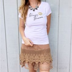 NOW AVAILABLE We LOVE Bling Soft 100% COTTON TEE. Verbiage: Bisou Bisou. The lips are adorned with gold glitter appliqué. Runs approx one size small. Measurements upon request. Model is wearing size Large, and typically wears size medium in t-shirts. 2-1-1-0 S, M, L Tops
