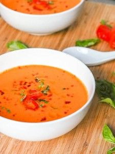 Seven ingredient creamy 30 minute healthy and delicious #vegan roasted red pepper soup gets an extra pop from the addition of coconut cream and tahini. Rich and vibrant. | avocadopesto.com