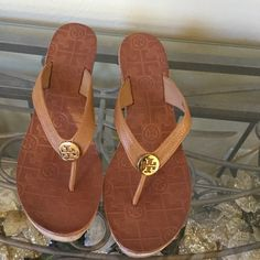 """Brand New Tory Burch Cork Wedge Slip-ons These pebbled leather thong sandals feature a logo medallion. 1.25"""""""" cork platform and 3"""""""" cork wedge heel. Rubber sole. * Made in Brazil. FIT: True to size. - Royal Tan"""" NWT No trades. Reasonable offers will be considered. Tory Burch Shoes Wedges"""