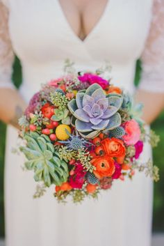 bright bouquet with succulents, photo by Brian Evans Photography http://ruffledblog.com/free-spirited-palm-springs-wedding #weddingbouquet #flowers #bouquets