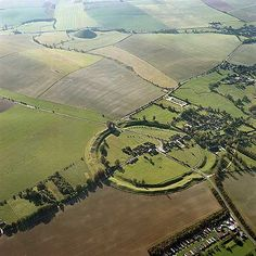 Avebury and Silbury Hill, Wiltshire. The large henge site of Avebury with its internal stone circles dates from about 2,600-2,100 BC. In the distance, the enigmatic mound of Silbury Hill was the largest manmade mound in Europe. Both sites probably served a religious or ceremonial purpose.