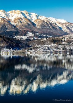Lake Caldonazzo is biggest lake in the region of Trentino in northern Italy.The small town of Caldonazzzo is a traditional resort very typical of the area and is situated on a plain between the lake, a stream and the marvellous green meadows and apple orchards of the surrounding area. Although spring has officially arrived, winter is still very much present.