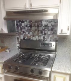 """Eden Mosaic Tile Modern Cobble Stainless Steel With White Glass Tile - EMT_W1144-MIX-CB. """"...I really like them. I wanted something that looked different than what people are trending in homes yet it had to have lots of stainless but white tiles too that would match the painted cabinets. We put stainless steel bars next to the granite to give the job a clean finish..."""" Testimony by Bruce M."""