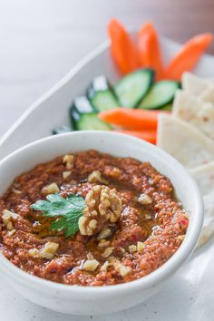 Muhammara Recipe:  a dip/spread made with breadcrumbs, tahini, walnuts, bell peppers,   red onion, pomegranate molasses, Syrian chili paste, tomato paste, and ground cumin