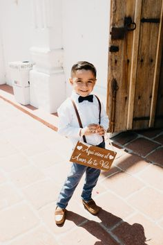 This adorable ring bearer wore suspenders a bowtie Ruby Wedding Rings, Gold Diamond Wedding Band, Wedding Ring Designs, Luxury Wedding Venues, Destination Wedding, Ring Bearer Outfit, Ring Bearer Suspenders, Ring Boy, Star Wedding