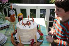 cool knight medieval theme cake and party - great shot of rainbow cake made with natural food dye and cool homemade pinata at the link.    http://www.littleredcaboose.ca/...