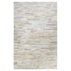 Showcasing a subtle tonal stripe motif, this hand-stitched cowhide rug offers luxe style for your floors.   Product: Rug