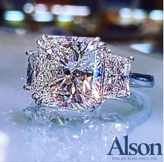 Spectacular 8.13 radiant diamond accented with two trapezoid diamonds.  Call 216-464-6767 for more information.