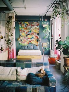 From the patchwork denim sofa and dip-dyed room divider to the upcycled ceramic sconces and incredible knotted rug hanging over the bed, we simply couldn't love this LA loft more.