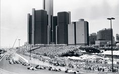 Ayrton Senna leading the Detroit Grand Prix, with the Renaissance Center looming in the background. From 1982 to Detroit was an annual stop on the Formula One racing circuit. The street course was considered one of the toughest on the circuit. Renaissance Center, Detroit Rock City, Detroit Motors, Detroit History, Detroit Michigan, Amazing Architecture, Le Mans, Wonderful Places, Grand Prix