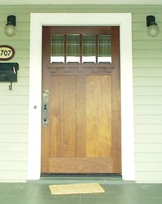 335 CRAFTSMAN ENTRY DOOR    Large craftsman entry door with flat panels and beveled glass. By Versatile Sash.