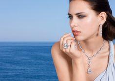 Graff -   Multishape Diamond necklace with a 33.11ct D Flawless pearshape Diamond pendant (Diamonds 92.56cts) 38.12ct Emerald cut Diamond ring Pearshape and heartshape Diamond earrings with 11ct emerald cut Diamond drops (Diamonds 36cts)
