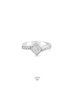 Handmade 18ct white gold engagement ring set with a .50pt diamond.