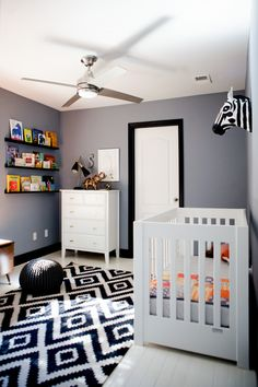 Black, white & gray graphic nursery love the black trim and white painted floors for the boys' bedroom