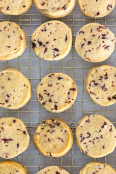 Glazed Hibiscus Shortbread Cookies cooling before they get the vibrant pink glaze, recipe by Baking the Goods.