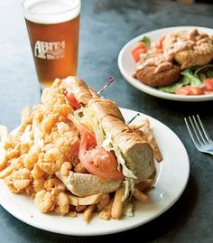 A shrimp po'boy and crawfish cakes at Abita Brew Pub in Abita Springs, La.  (Michael Mohr) From: America's Best Food Regions.