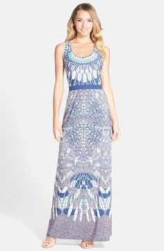 Free shipping and returns on BCBGMAXAZRIA 'Adriene' Print Stretch Maxi Dress at Nordstrom.com. Neutral cool tones give versatility to the kaleidoscopic border print animating this fitted maxi dress. A comfortable waistband and uniquely twisted open back add more winning detail.