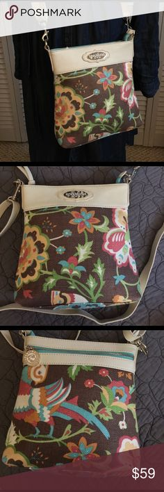 Spartina Crossbody Bag Beautiful Spartina crossbody bag with adjustable strap.  This like new bag is made of white leather and canvas and with a zippered pocket on the back and one inside along with two cellphone size pocket. Spartina Bags Crossbody Bags