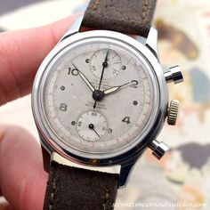 A 1950's era Olympic Watch Co. Chronograph timepiece with a beautifully, patinated silver dial that features aged, luminous Arabic numerals and dot markers. This two-register watch wears well on the wrist, clocking in at 36mm, & has a 17-jewel,...    #olympic #olympicwatchco #chronograph #vintagechrono #syringehands #buttonpushers #vintagewatches #classicwatches #classic #vintage #watch #watches #cool #wristwatch #collectible #timepiece #stawc