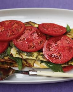 "Grilled Vegetable and Tofu ""Lasagna"" with PestoThere are no noodles to be found in this vegan, gluten-free ""lasagna"" that makes the most of ripe summer produce. Grill squash and tofu, then marinate it in lemon-and-garlic-infused olive oil before layering with homemade pesto and fresh tomato slices."
