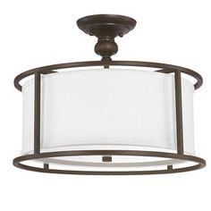 Illuminate your living room or master suite with this chic flush mount, showcasing a white fabric shade. Product: Semi-flush m...