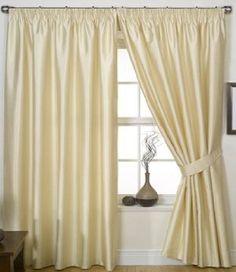 Cream Curtains with chrome curtain rail