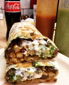 The California Burrito this delicious and mythical burrito is filled with Carne Asada Cheese Guacamole Sour Cream and French Fries rolled into a Flour Tortilla [I ATE]