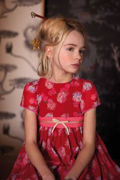 In Chinese culture, red is the colour of good fortune and any girl would be delighted to own this stunning red Chinese flower print party dress. Fabulously full girls party dress with slim bodice, fixed waist tie detail, and layers and layers of net under Chinese Flowers, Kids Branding, Girls Party Dress, Chinese Culture, Punk Fashion, Little Girls, Floral Tops, Oriental, Red