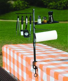 Backyard barbecues and picnics in the park will never be the same thanks to this innovative organizer. Featuring four double-sided hooks, a paper towel holder, a shelf and a screw clamp mount that easily mounts to grills and tables, this organizer adds ease and efficiency to preparation.