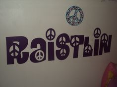 wall decal in my daughters room with a peace sign decal she won from selling girlscout cookies
