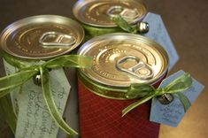 Cool gift idea.  Open the can from bottom, fill with what you want....glue bottom back on....decorate the way you want and give....