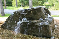 Large boulder drilled to make bubbling rock feature for landscaping pleasure.  http://www.naturestouchlandscaping.com/minneapolis-st-paul-landscaping-water-features/