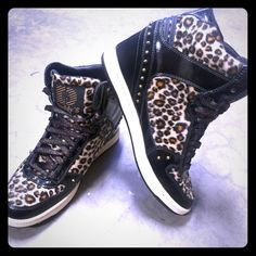 Daddy's Moolah Leopard Wedge Sneakers NWOT Brand new without box. Never worn. Size 9, true to size. Perfect condition!! These bad boys are so comfy and cute! They look great with skinnys and a baggy top! Studs along back. Soft faux leopard fur. Skechers Shoes Sneakers
