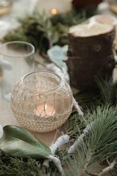 centerpiece.   Love the doily or crocheted or even just some twine around mix matched glassware with little lights