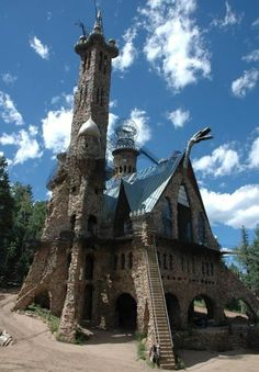 Colorado! Bishops Fairytale Castle- There is even a dragon on the premises. Its scales are stainless steel scrap from a local hospital, and it breathes fire from a hot air balloon burner.