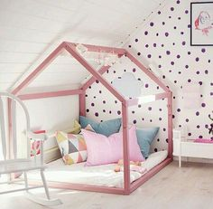 e: love this blush bed frame and polka dot wall.
