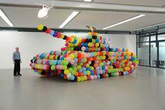 Hans Hemmert.  http://www.booooooom.com/2010/03/03/balloon-sculptures-by-artist-hans-hemmert/  - If only...
