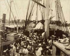 """Foto. Javaanse immigranten in het depot na aankomst in Paramaribo met het schip de """"Voorwaarts""""Datecirca 1894....fotograaf Julius Muller"""