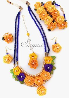 Keep up with the latest trend in bridal fashion by sporting Ribbon flower jewelry for your pre wedding ceremonies like Haldi and Mehendi Thread Jewellery, Lace Jewelry, Fabric Jewelry, Indian Jewelry, Wedding Jewelry, Jewelery, Handmade Jewelry, Flower Jewelry, Floral Necklace