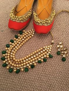 Orange Punjabi Juttis lined with extra cushion and embellished with ghungroos and Emerald Kundan and Pearl Indian Jewellery set. Buy at www.tyche-London.com   Delivery worldwide. 3-5 days in the UK