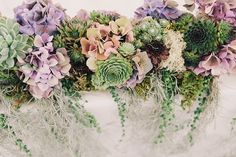 Gorgeous succulent floral decor, from 'A 1920s Jazz Age, Prohibition and Charleston Inspired Vintage Wedding', photographed by http://www.brighton-photo.com/