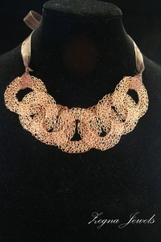 Copper wire Crocheted statement necklace and earrings set. $125.00, via Etsy.
