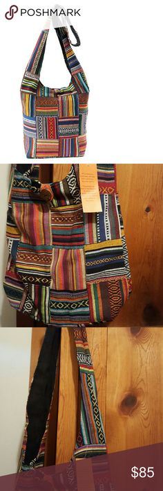 """Beautiful large vibrant ethnic blanket hobo bag Handmade high quality free trade ethnic woven patchwork multi color Hobo bag. Cotton, inner lined, button closure, one inner zipper pocket. 23"""" shoulder drop, 14.5 """" W, 13"""" H, 6"""" D approx measurements. Very on trend! Boho, festival, Mexican blanket, hippie chic, shoulder bag, cross body. Kathmandu Bags Hobos"""