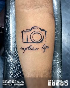 "Camera is the first love of every Photographer. And as the quote truely says ""Capture life"", he does the same.. Relate to your profession with a tattoo and strengthen your goals towards it... For such Profession related tattoos visit @181_tattooz_studio Creative Tattoos, Fish Tattoos, Tattoo Quotes, First Love, Goals, Studio, Life, Study, Quote Tattoos"