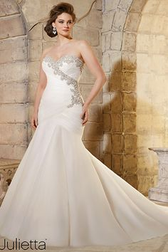 """Mori Lee, Style 3187""""Accentuate an hourglass shape with a dramatic fit-and-flare gown. This gorgeous dress by Mori Lee has beadwork and ruching in all the right places to flatter any figure!""""Photo courtesy of designer"""