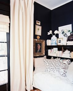 love the balance of the thick white curtain with black paint + a small salon wall